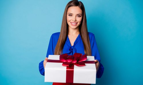 Photo of attractive business lady hold arms big giftbox present from colleagues receiving best gift wear red luxury trousers suit blouse shirt isolated blue color background